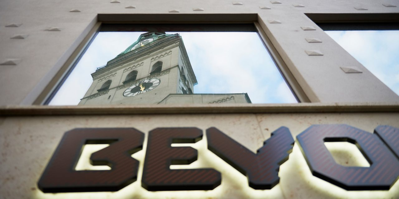 "The ""Alte Peter"", the tower of a well-known Munich church, is reflected in the glazed hotel façade with the BEYOND lettering."