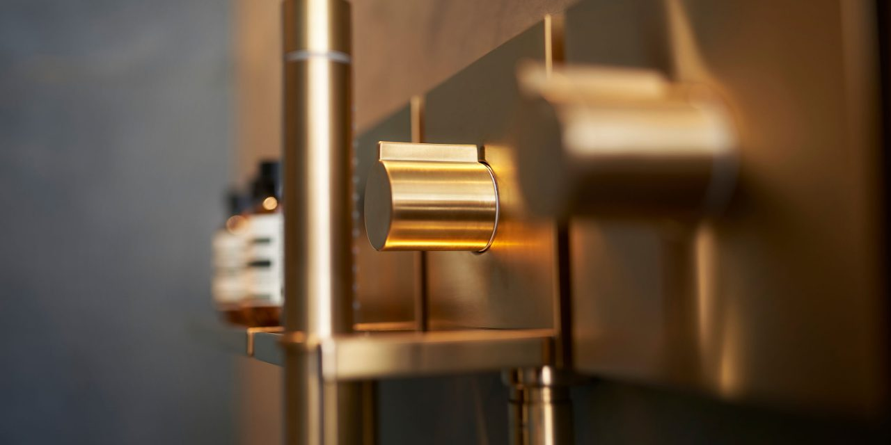 Detailed view of the luxurious golden bathroom fitting in the BEYOND Hotel Munich