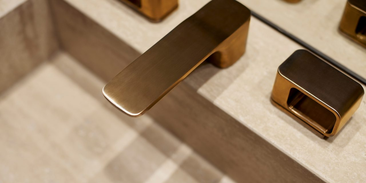 Close-up view of a golden tap on a washbasin