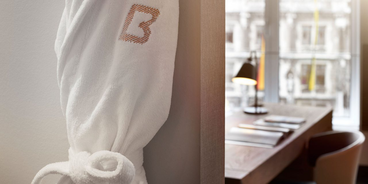 A BEYOND bathrobe hanging from a hook in a hotel in downtown Munich - in the background you can see the hotel room