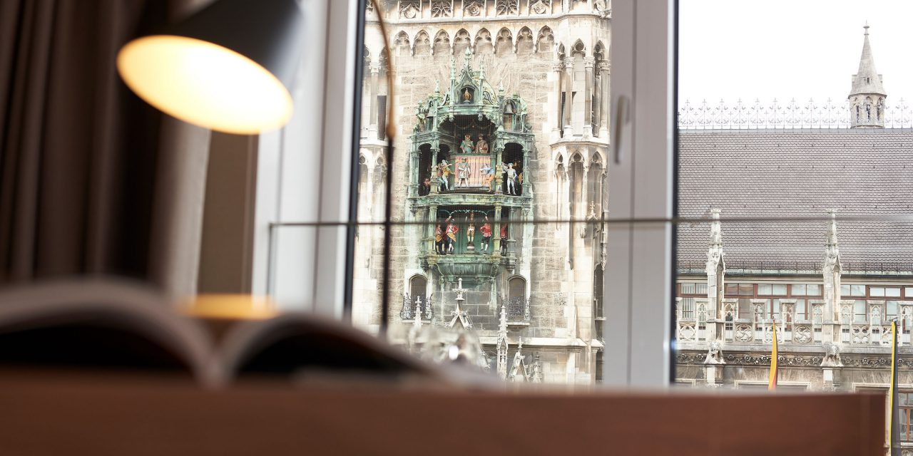 View from the panorama windows of the BEYOND-Hotel onto the tower of the Munich City Hall.