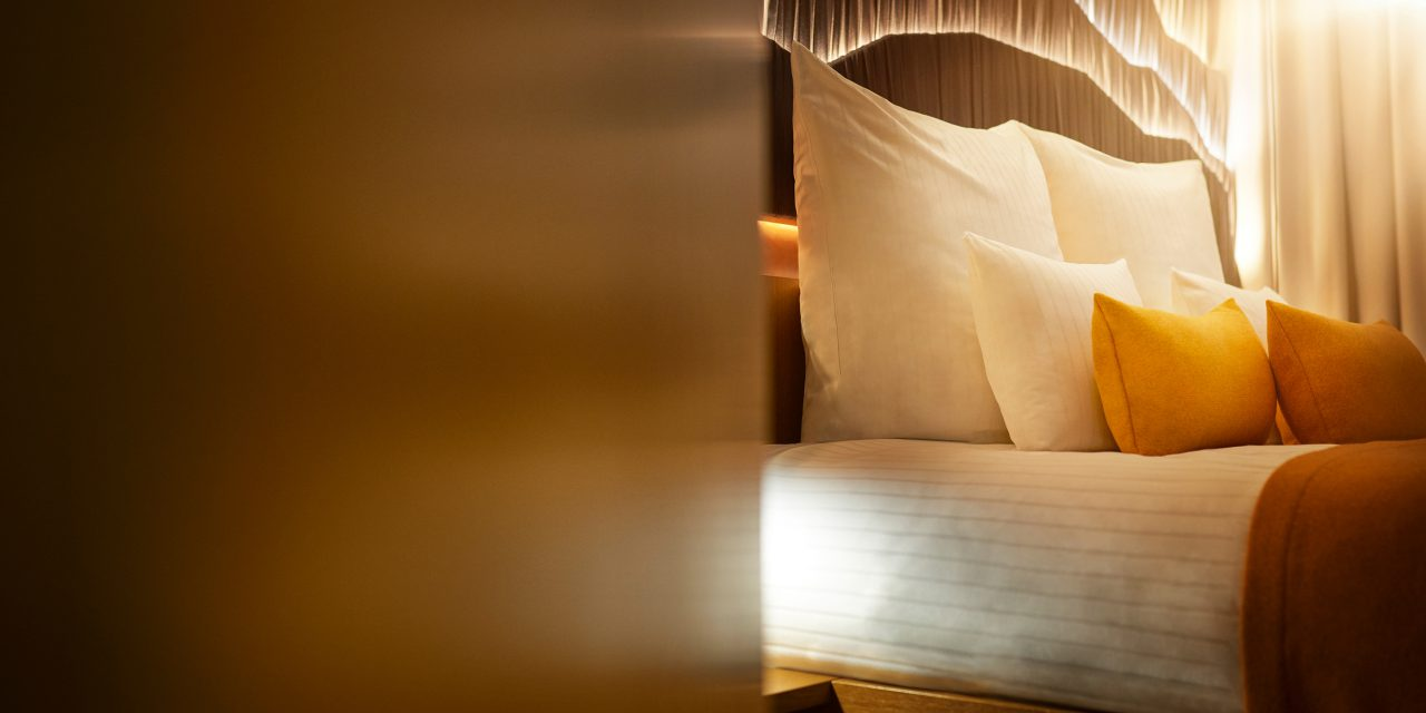 Close-up of a large and cosy hotel bed in the BEYOND-Hotel Munich